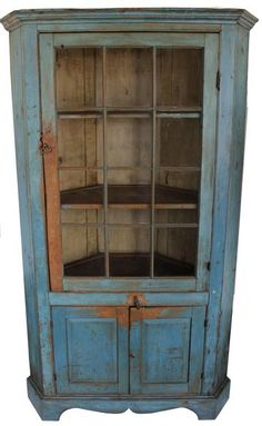 85 19th century Pennsylvania 12 pane Corner Cupboard over two raised panel door with a wide bracket base,mustard interior  circa 1840 in original blue paint Kutztown,  Burks Co. area