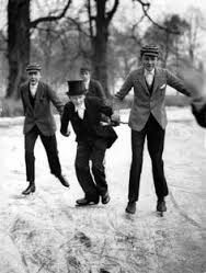 This is from 1929 and therefore not consistent. But curious. Eaton boys skating to school.(Eaton has always been very conservative so uniforms haven't changed that much over the years). Something like Eaton in the 1910s but for girls (for the sake of the uniforms)?