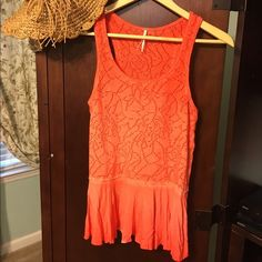 Free People Peplum Top NWOT size XS ✨ Tangerine sleeveless top with a little flare to the bottom. Very cute!  No flaws. Free People Tops