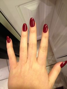 Blood red almond shaped nails... Love them!