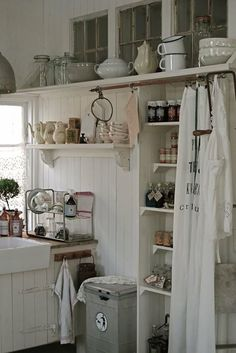 Really like the curtain over the pantry. Curtains often make more sense than a door, but aren't often used anymore.