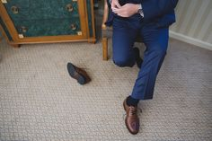 A photojournalistic photograph of a groom getting ready at the Langham Hotel before his wedding at the State Room in Boston, Massachusetts Gina Brocker Photography