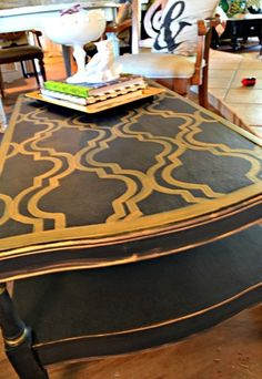 black painted coffee table with interesting stencil design painted on top