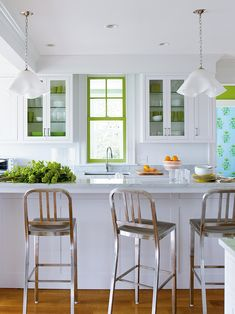 If your existing white kitchen just needs a little pick-me-up, take a cue from designer Katie Ridder and turn to budget-friendly paint for the fix. She painted just the mullions, but not the window frame, in a cheery apple green then put a few matching pieces of green dishware on display in the glass-front cabinets. Get 9 more budget-savvy kitchen update ideas.