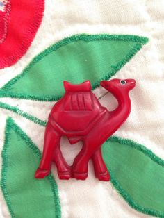Carved Red Camel Vintage Bakelite Pin.
