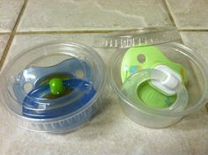 Keep pacifiers clean on-the-go by storing them in souffle cups. #BabyTips