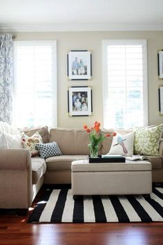 Photo by: A Thoughtful Place    A new look for living rooms are fabulous, striped rugs! These fun rugs bring energy to any room and make us #HomeGoodsHappy