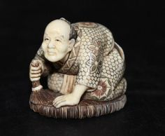 "Japanese Finely Carved Ivory Netsuke. Featuring man brushing floor. Weight - 47.8 grams. Measures - 1 1/2"" high."