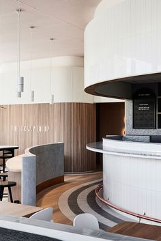This is not: A boring coffee shop. This is: An exciting new local for Box Hill residents. At the base of the new Australian Tax Office building, The Penny Drop Café was designed in collaboration with Pop & Pac, playing on the concept of the 'penny dropping' from the pockets of the ATO office above. Art deco light fittings and textured surfaces create a friendly and inviting space to start your day, and the large, curved bar makes for a cool place to wait for your morning coffee. Photograp...