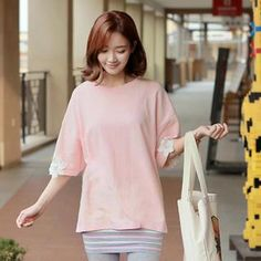 Buy 'CLICK – Elbow-Sleeve Oversized Lace Trim Top' with Free Shipping at YesStyle.co.uk. Browse and shop for thousands of Asian fashion items from South Korea and more!