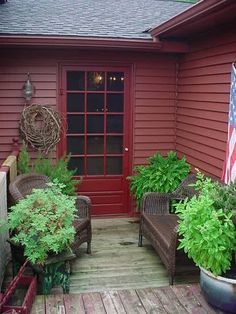 Cottage red. Idea: paint the house in matte finish and the door the same color in gloss finish.