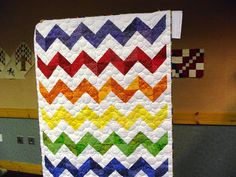 Love the colors, even starting to like half square triangles.