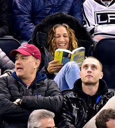 Just Sarah Jessica Parker reading Maggie Shipstead's Astonish Me at a hockey game.