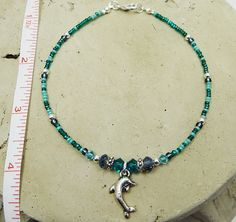 Anklet Ankle Bracelet Dolphin Charm Teal Blue by ABeadApartJewelry Sea Jewelry, Jewelry Crafts, Jewelry Ideas, Beaded Jewelry, Beaded Necklace, Beaded Bracelets, Necklaces, Blue Crystals, Swarovski Crystals