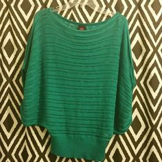 Knitted Teal/Turquoise batwing Sweater Knitted Teal/Turquoise batwing Sweater brand is Bebe size Medium. In great condition bebe Sweaters Shrugs & Ponchos