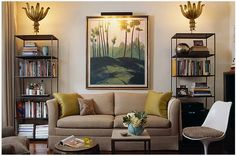 living rooms - Saarinen Tulip Table gold silk pillows beige sofa iron bookshelves art end table  Taupe sofa, yellow silk pillows, tulip saarinen