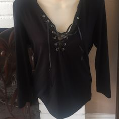 Black 3/4 sleeve lace up top Black lace up top with 3/4 sleeve- worn once The Classic Tops Blouses