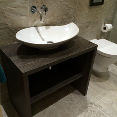 This eye catching, designer looking basin really makes a statement in the bathroom. Fantastically offset with the dark finish of the unit. The elegant style perfectly continued with the wall mounted mixer. A sleek & elegant bathroom. Bauhaus - Leaf countertop basin @crosswater - Kai wall mounted basin mixer. @daval_furniture - Made to measure basin unit - Wenge finish. Waxman Ceramics - States Snow, Porcelain tiles. Countertop Basin, Countertops, Wall Mounted Basins, Basin Unit, Sink Units, Porcelain Tiles, Basin Mixer, Bauhaus, Furniture Making