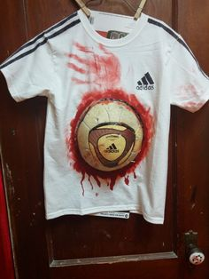 Zombie Soccer Player   For the Shirt You'll need:   1 white t-shirt  1 old soccer ball  black marker  scotch tape  piece of p...