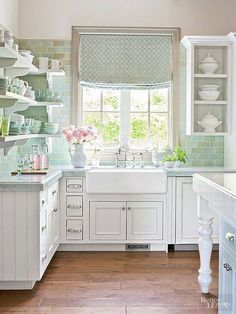 Pretty white shabby chic kitchen , especially love the pale green country style tiles Anna Www.melodymaison.co.uk