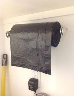 Paper towel holder used as trash bag holder