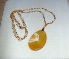 Genuine Banded agate slice necklace in yellow with gold chain/longer length on Etsy, $21.97