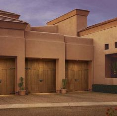 Clopay Canyon Ridge Collection faux wood carriage house garage door on Southwest style home. Design 12. www.clopaydoor.com