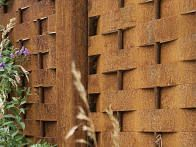 Woven horizontals made of softwood are help up by sturdy wood block verticals and bottom edgings, creating an attractive and effective fence.