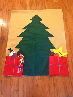 I am pretty confident I can make this. I really like the idea of presents to hold all the ornaments. I wonder if I could use burlap for the backing...