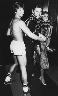 Helmunt Berger & friend with a busboy at Studio 54