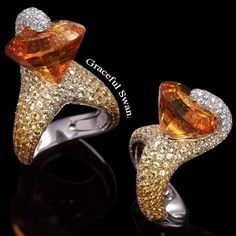 palmierojewelleryGold is melt and transformed into the shape of a graceful swan set with a fine pavé of diamonds and sapphires. Suspended...an orange citrine.
