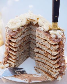 "TESS BEGG ∙ V E G A N on Instagram: ""Feast your eyes on this giant stack.. PEANUT BUTTER BUCKWHEAT PANCAKES w/ nanas, macadamias, coconut & a creamy choc-pb sauce Enjoying them on this fine sunny day #vegan (don't forget to check out the almond butter muffin recipe vid link in bio)"""