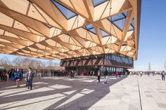 mecanoo designs gatehouse topped with a timber canopy for keukenhof flower garden
