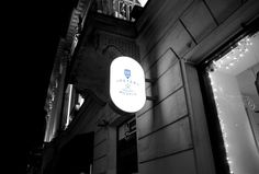 Shop Sign by Night Mockup | MockupWorld