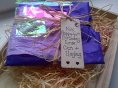 Wrap ur gifts with simplicity a few sheets of tissue paper some raffia and a personalised wooden tag  http://www.facebook.com/craftyhandss