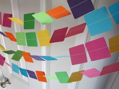Paint Party Garland! Just sew together paint chips with a sewing machine. Cute way to add color here and there