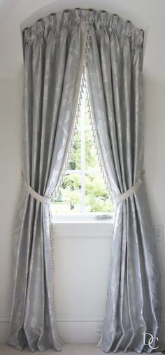 Goblet Pleat Shirring tapes available through VENUS Decorative Hardware.  So easy! 888-771-1037 orders@venusdh.com Goblet pleat draperies in an arched window with decorative fringe.