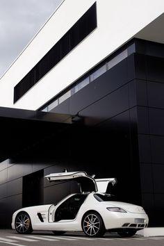 white Mercedes Benz SLS AMG GT – b/w architecture