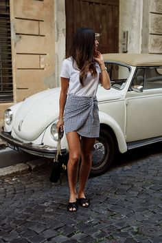Tie on your own gingham fabric and there you have it - a creative wrap skirt. All it needs is a white tee shirt and flat black mules. Cute and clever. Style Planet