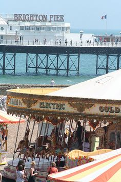 Carousel on Brighton beach with Pavilion Pier in the background