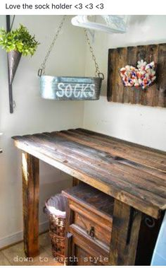 Rustic table might snag clothes, but the sock bucket idea is great! Down to Earth Style: Old Fence Features in the Laundry Room. LOVE that table and the matching one on the wall as well as the cool sock bucket. Laundry Room Remodel, Laundry In Bathroom, Laundry Rooms, Basement Laundry, Basement House, Laundry Room Organization, Laundry Room Design, Laundry Sorter, Laundry Room Folding Table