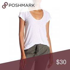 James Perse Deep Neck White Tee Brand new with tags, women's size 3. A size 3 is equivalent to a size Large according to James Perse' sizing chart. This James Perse Deep Neck White Short Sleeve Tee is your perfect white T-Shirt! So versatile! Pair with it with favorite jeans, shorts, skirt or dress it up with a blazer. Very soft and comfortable. Made of 51% Cotton and 49% Modal. Retails for $95! James Perse Tops Tees - Short Sleeve