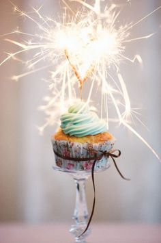 I love the idea of putting one cupcake up on a candlestick for the birthday girl!