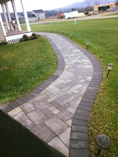 Your home could be the envy of the block with this entryway! Four Leaf Landscape LLC installed this beautiful entryway using Cambridge Pavingstones with ArmorTec. What would your front yard look like?