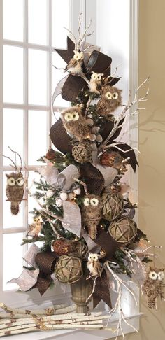 Cornucopia centerpiece...the owls are so cute! Would look great using the new bark looking paper garland ribbon.