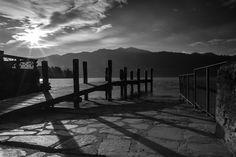 Dock - Orta Lake Italy - italian photographers photographers on tumblr original photographers original photographer original content lensblr tumblr radar photography photo tumblr2016 iamared canon photooftheday photograph photographer andreagracis andreagracis.com dock flare blackandwhite lake orta water