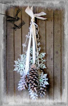 White Glittered Snow Flake,silver bellsand flocked Pine cone wreath chair tieback Gifts under 25. $14.99, via Etsy.