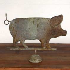 "$46.00 This rustic pig looks like he could have been mounted on the weather vane, but was rescued and now sits on your mantel. Our Metal Pig on Stand measures an impressive 23"" long, so this big pig will be a hefty focal point where you choose to place him. A pig figurine oinks farmhouse charm, and this porker will be a fun addition to your farmhouse style.   Made of metal. Dimensions: 23"" x 3"" x 12"" H."
