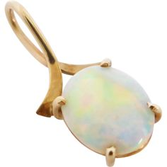 This minimalist solid opal pendant boasts one solid crystal opal in a gleaming 9ct gold claw setting. Vintage c1970