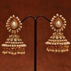 Anvi's designer polki pearl jhumkas with pearls and white stones